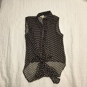Black top with white polka dots and tie bottom